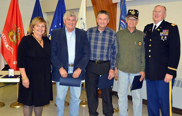 L-R: First Lady Ann LePage poses with the three Belanger Brothers who served in the Vietnam War. The