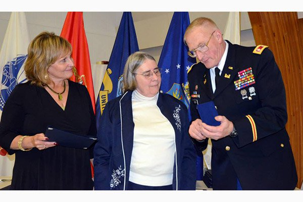 State of Maine Gold Star Honorable Service Medal being awarded to widow, Dorothy Hopkins, for her hu
