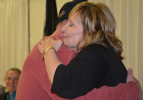 Well-deserved hugs to Veterans of the Vietnam War from First Lady Ann LePage at the Appreciation Din