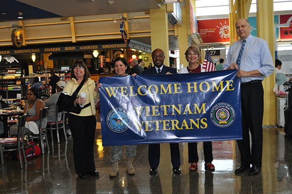 Greeters await visiting Vietnam Veterans arriving on an Honor Flight sponsored by Old Glory Honor Fl