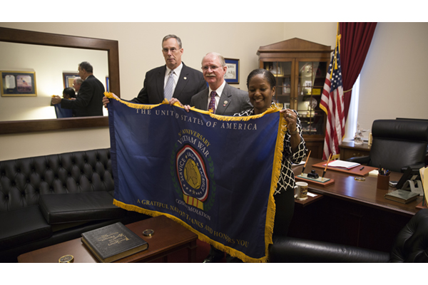 Congressman John Rutherford (R-FL 4th District) is presented with the commemoration flag.