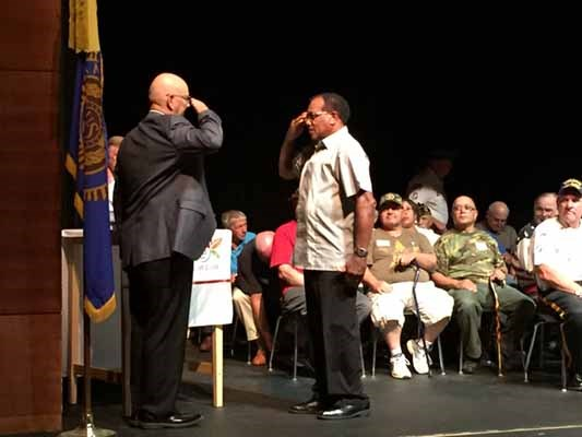 A Vietnam Veteran salutes with Allen J. Lynch at a special ceremony hosted by JourneyCare.