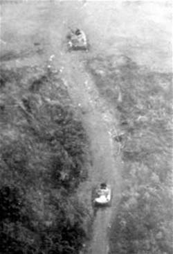 Two Knocked-out PT-76 Tanks near Lang Vei