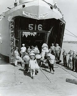 Vietnamese Refugees Board a US Navy Vessel