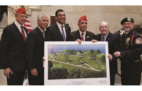 Secretary of Veterans Affairs for Massachusetts, Francisco Urena, poses with veterans
