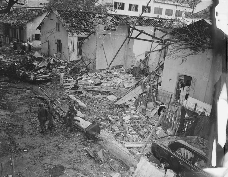 Photo showing a portion of the aftermath of the bombing in the rear of the hotel/billet, December 24, 1964