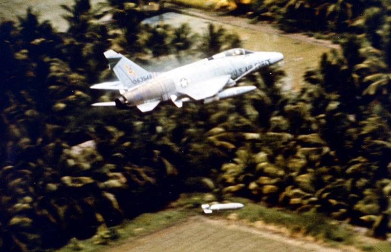 F-100 Super Saber releasing a bomb over the Mekong Delta, unkown date. Major Geirge Smith was flying an F-100 when he was shot down on April 3, 1965.