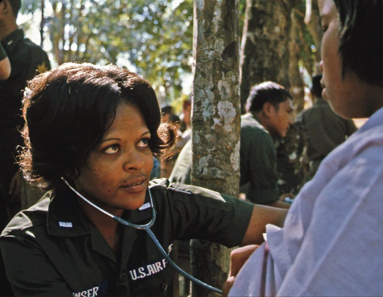 First Lieutenant Linda J. Bowser, an Air Force nurse with a MEDCAP team, examines a Thai girl, Bong Son Village, Thailand, January 10, 1974.