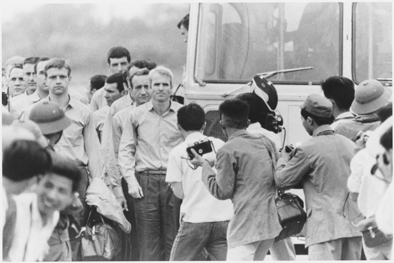 McCain waiting with his fellow ex-POWs at a Saigon airport just after their release, 1973.