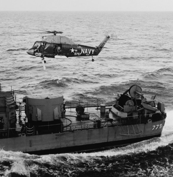 A Navy UH-2 Seasprite picks up a crewmember from the destroyer USS Douglas H. Fox for transportation back to the aircraft carrier USS Franklin D. Roosevelt, August 12, 1964.