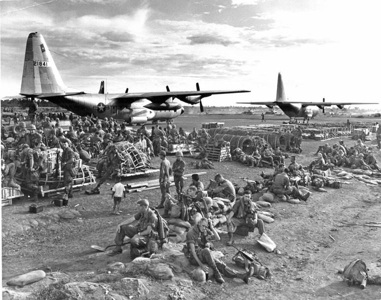 U.S. soldiers unload from U.S. Air Force C-130s at Dau Tien in preparation for Operation CEDAR FALLS, January 7, 1967